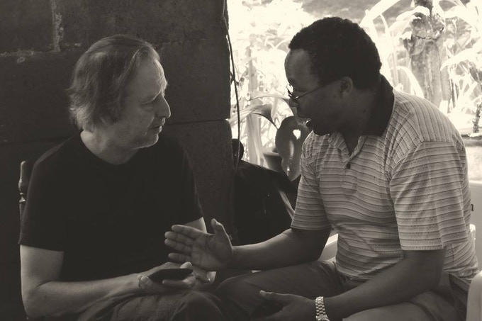 """School founder Al Giordano confers with Mkhuseli """"Khusta"""" Jack, one of the South African anti-apartheid movement's most successful organizers."""