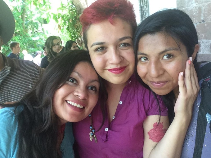 Abril Dávila, graduate and current professor of the school, with scholars Kati and Mimi.