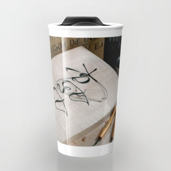 The mug shows a scene of work in progress on Alphabets carvings.