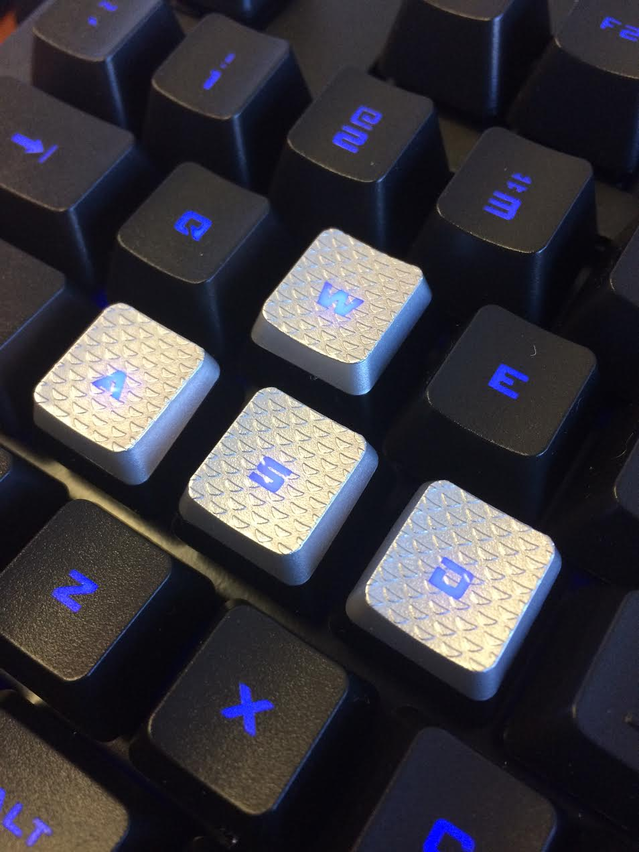 The WASD keys feature textured tops and 2 tone colors.