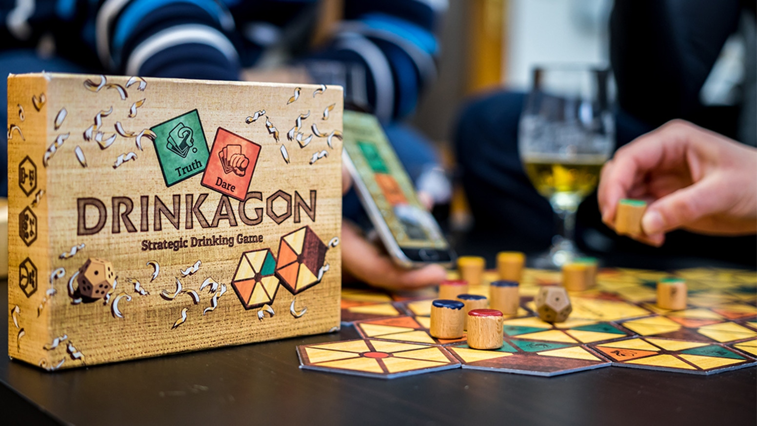 Board game for up to 8players that combines drinking vs. truth & dare and strategic thinking.