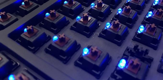 Through-hole mounted LEDs illuminate every key