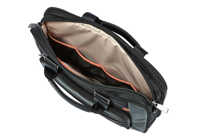 Main compartment has 4 interior open elastic pockets perfect for laptop wires, mouse, etc...