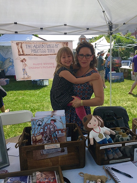 "Elizabeth Lorayne and daughter, Vivi Lorayne at the Newburyport Custom House Maritime Museum ""Maritime Days"" Festival selling books in May 2016."