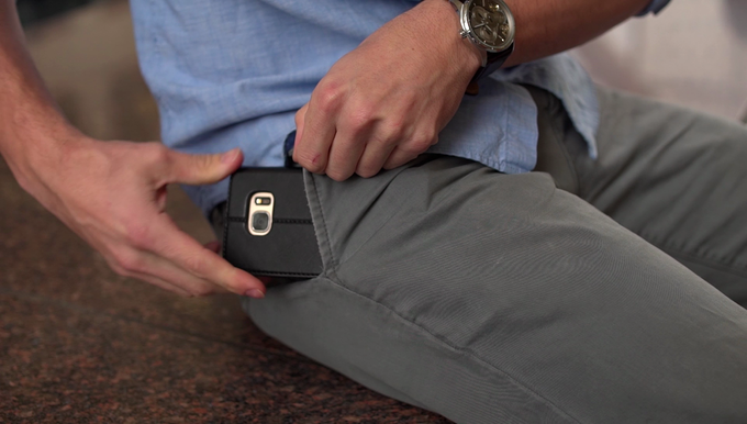 To block radiation while in your pocket, insert the phone with the shielded side facing towards you. The camera will face away.