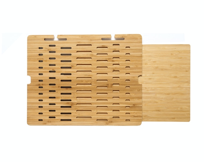 The Single Slide TabBord sports 1 wood bamboo space saving plank that slides EITHER to the right OR to the left side of the lapdesk.