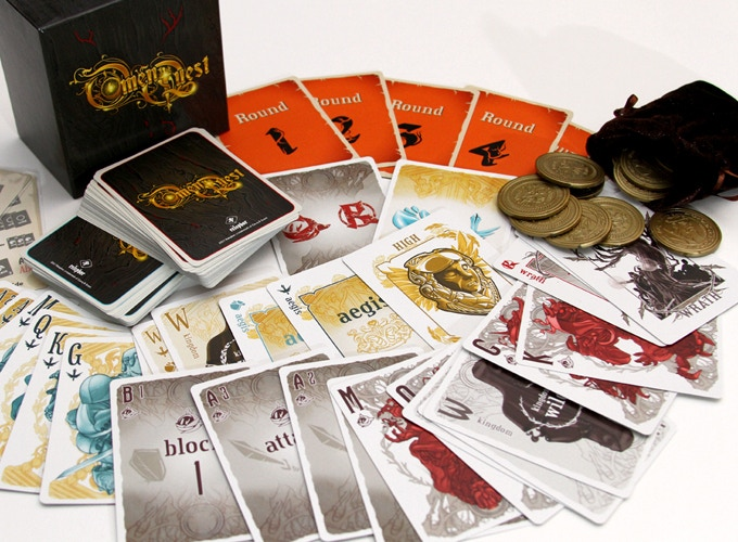 pictured: Omen Quest standard box, the coins, coin pouch, and all 98 cards. (not pictured is the tuckbox which will be included)