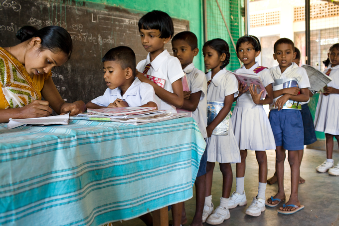 Children checking out books in Sri Lanka | Room to Read. Photo credit: Anne Holmes