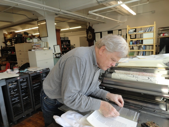 Bruce Kennett inserting a Linotype slug into a galley of type for the letterpress portfolio