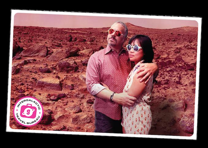 Visitors to the Intergalactic Travel Bureau pose on Mars.
