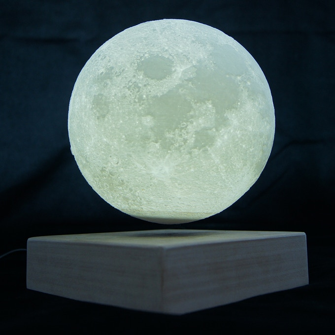 This is a working prototype of our floating moon light. The docking will be made of wood in our final production.