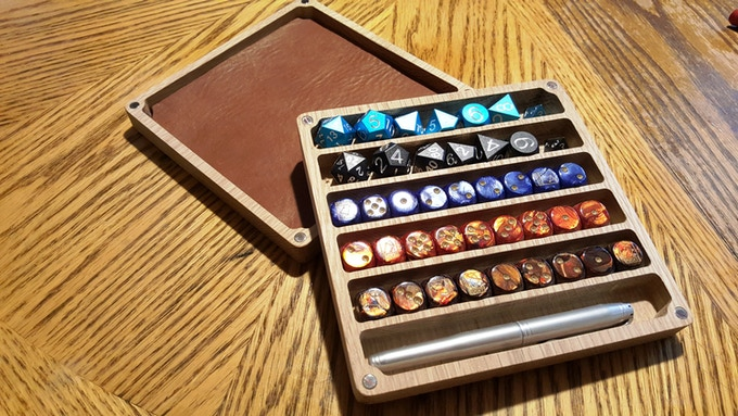 Tons of dice... multiple pens  and minis. Cherry and leather.