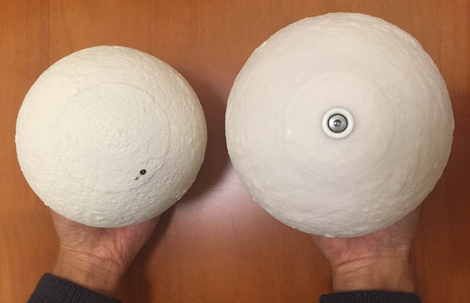 The one on the left is the redesigned version of our new levitating moon light. We have created a much small switch to control the color and the brightness of the light