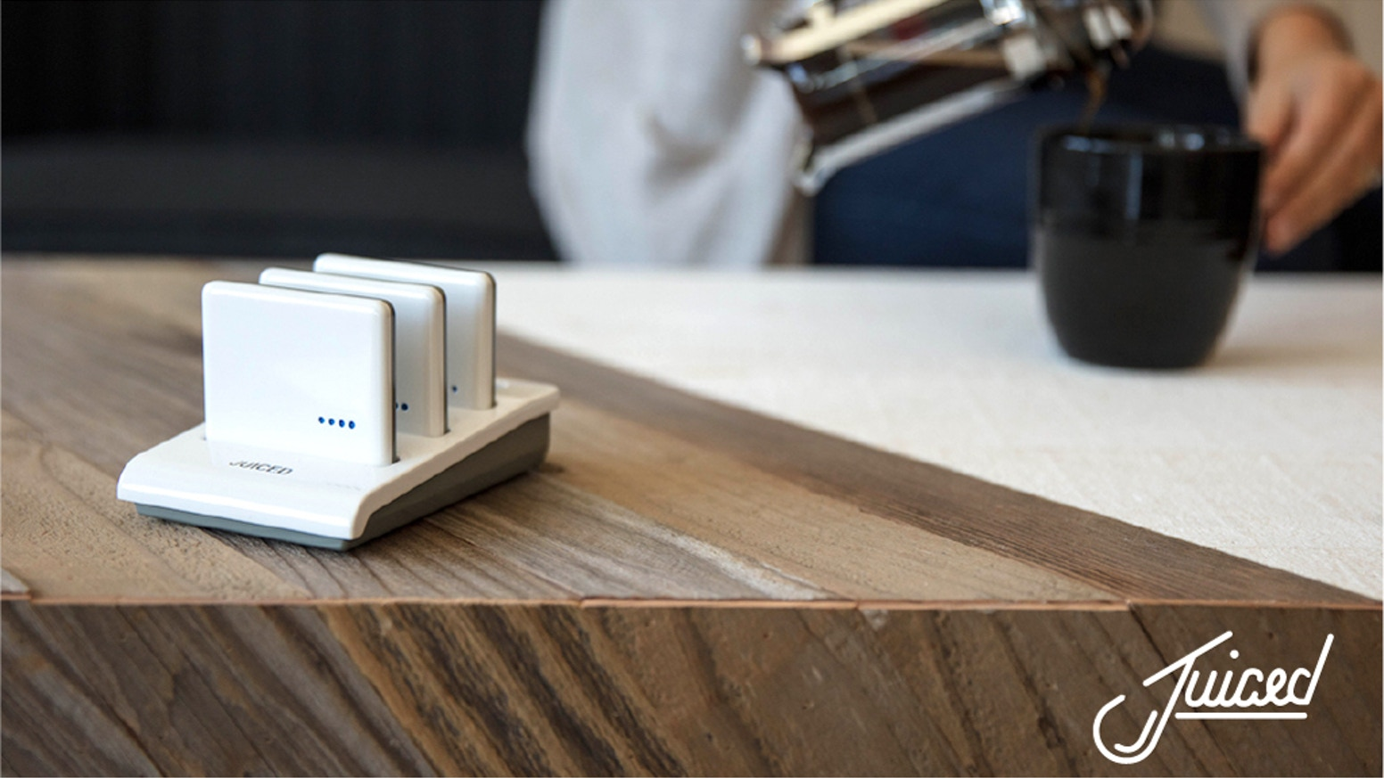 JUICED wireless group charging stations use pocket-sized phone battery packs with an extra 50% boost. Fast, convenient, indispensable.