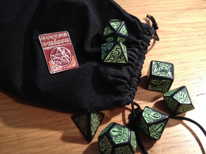 The Necronomicon displayed on a dice bag.