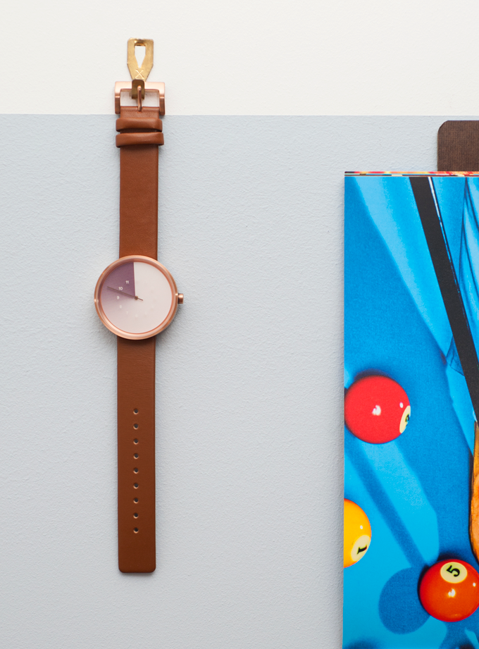 Coffee straps feature a matching rose gold buckle
