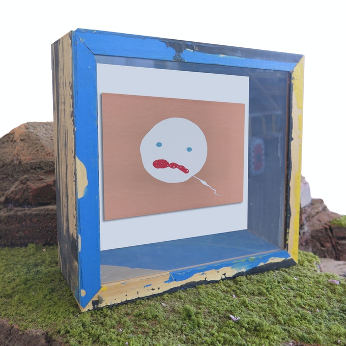 """Pledge $500 - Hand-painted """"Bruce-Faced"""" copper printmaking plate embedded in a one-of-a-kind, handmade shadow box by The Bruce High Quality Foundation. No two Bruce faces or shadow boxes are alike!"""