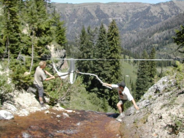 Affixing a hammock atop a waterfall in Wyoming