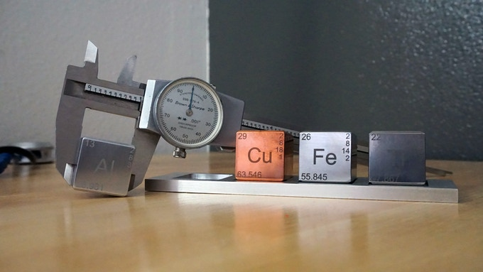 Calipers Measuring the Cubes