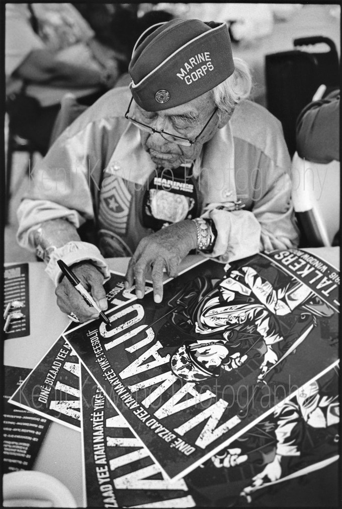 Teddy Draper Sr autographs a poster for a young supporter. This image and that of Sr at a local parade by Kenji Kawano.