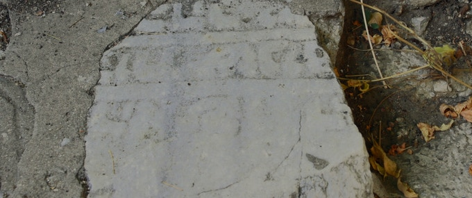 Jewish tombstone in stairs