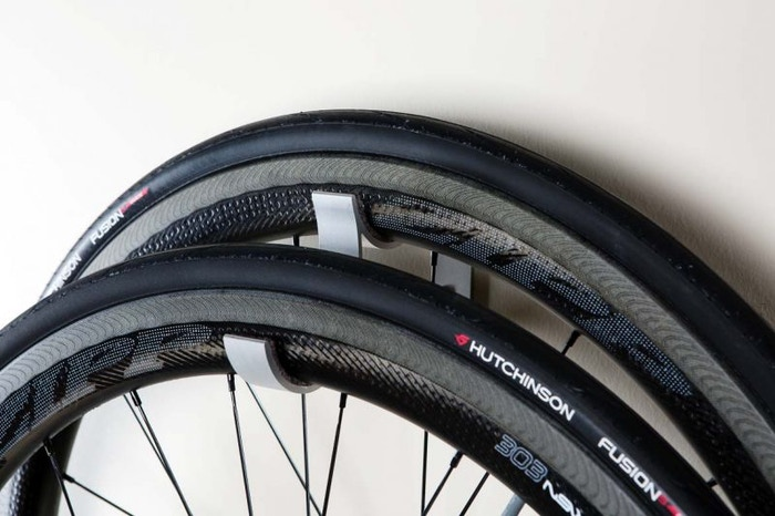 Bicycle wheel storage hook that keeps your wheels protected and off the ground (and looks good, too).