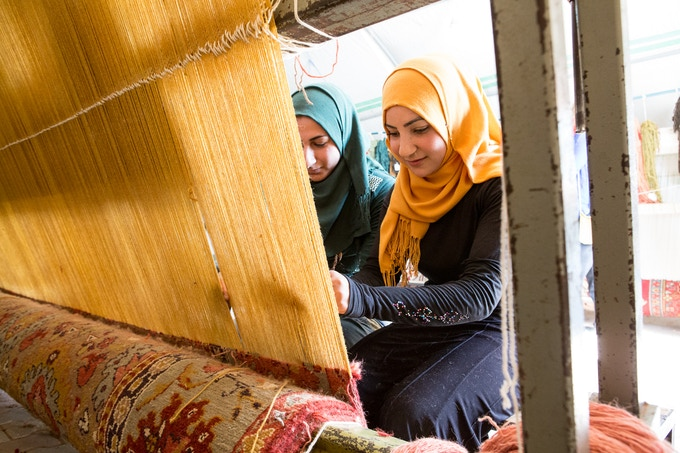 One weaver can knot about 10 sq ft per month; this rug will employ these women for nearly a year
