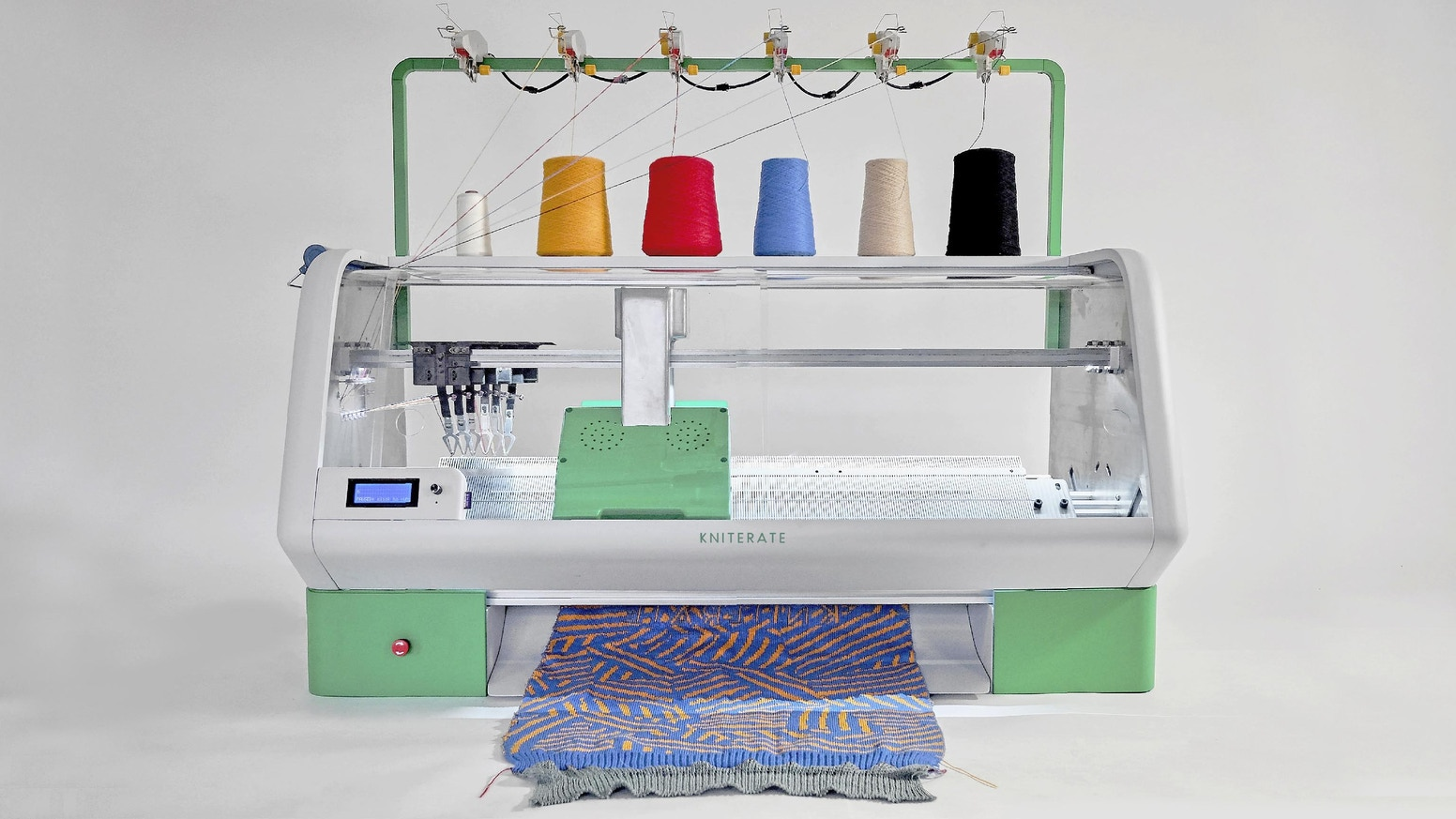 Create a design and press knit. A compact digital knitting machine to bring fashion fabrication back to your neighborhood.