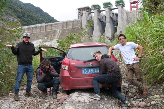The crew, and the real hero of Conquering Southern China, our Toyota Yaris rental car, stuck on terrible mountain roads in Guangxi