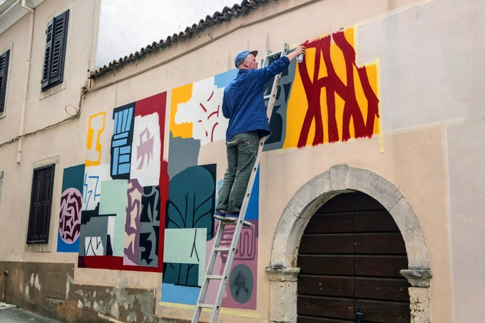 The artist will paint an original mural on a wall of your choosing. Photo by Mario Prhat.