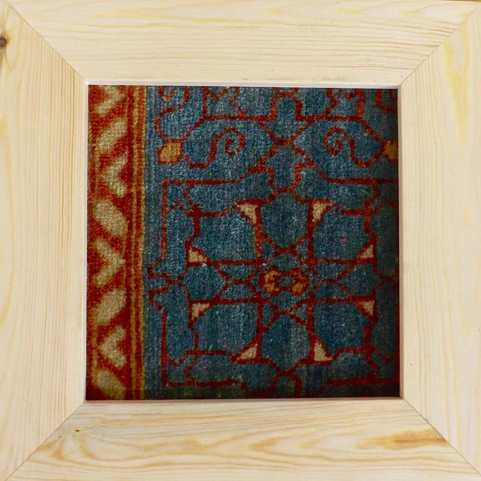 Show your support for Anka by hanging this handmade carpet fragment in your home or office