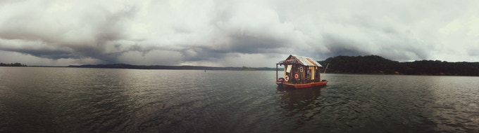 Secret History shantyboat under stormy skies