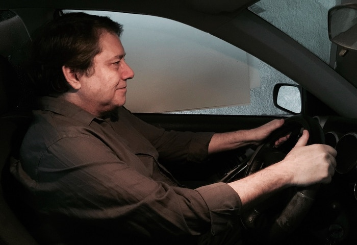 Jack driving - Still photo for the animatic (Video Storyboard).  The white backdrop will be replaced with a different background in the animatic.        ©Ginosaji Pictures