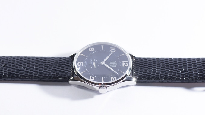 Plano silver/black featuring silver hands and a black lizard strap