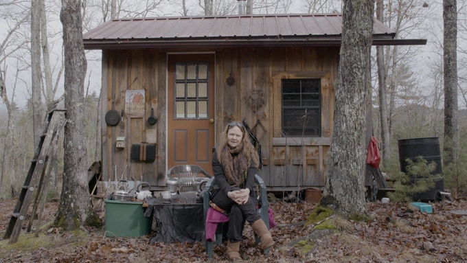 Jennifer, a former architect, built her own electricity-free cabin in the woods to seek refuge