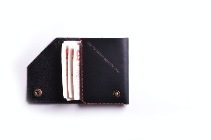 Charcoal leather, with inscriptions inside, red thread