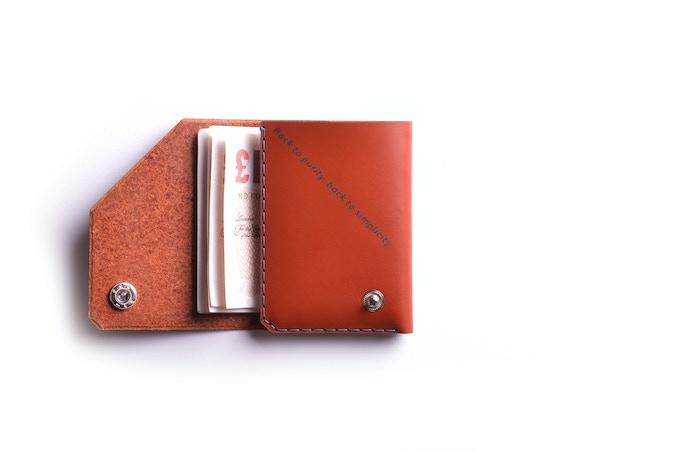 Cognac leather, inscriptions inside, turquoise thread