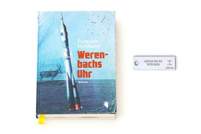 The adventure novel (only in German) and a piece of space rocket.