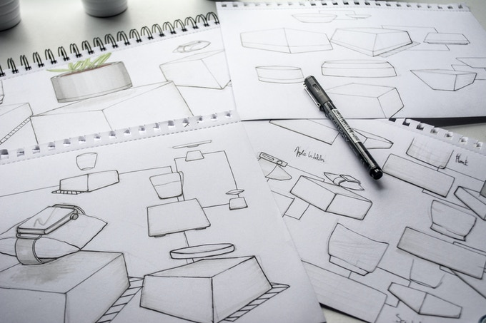 Early concept sketches for the base shape and the initial levitating design.