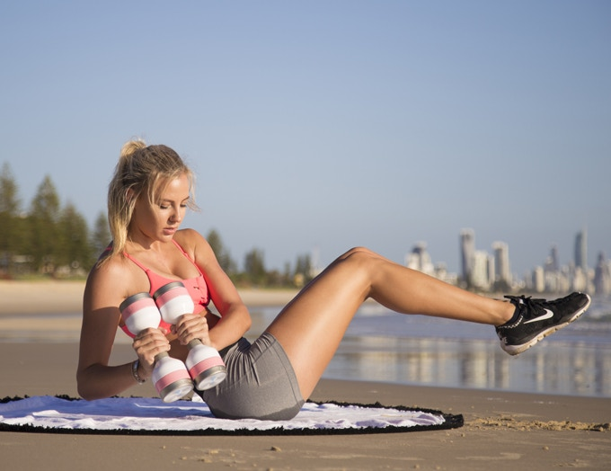 THE BEACH IS YOUR GYM: Wumbell side crunches