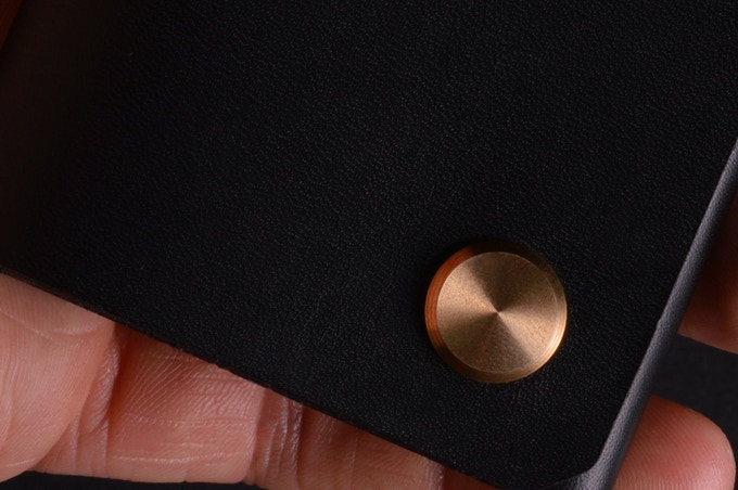 The brass machined fastener comes with a CD like finish and will age beautifully with the leather