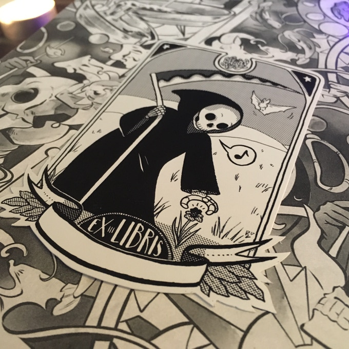 Close Up On Logo Mockup On Black Paper: TABULA IDEM: A Queer Tarot Comic Anthology Relaunch By