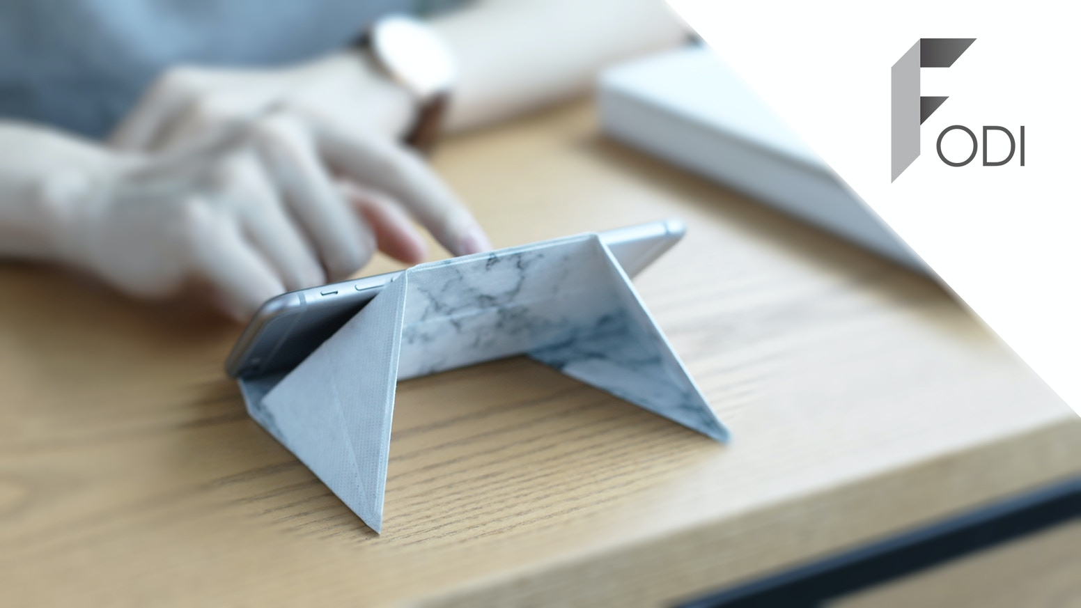 FODI Is An Origami Stand That Folds To Different Sizes Fit Your Mobile Devices