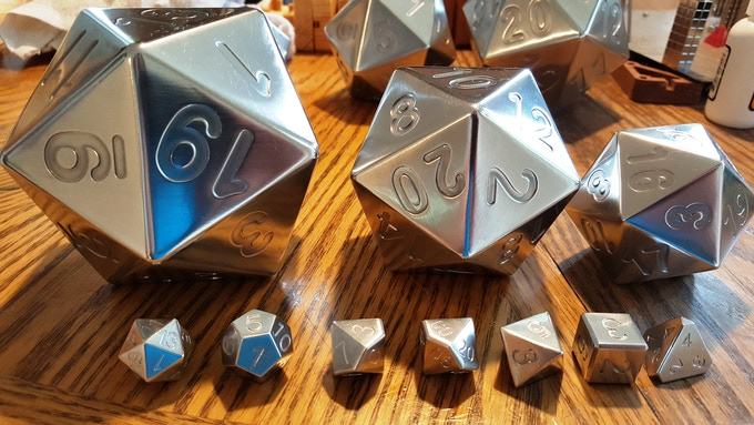 The polyhedral set of 7 in the front featuring evenly sized dice and re-formatted proportions to make each roll a joy.