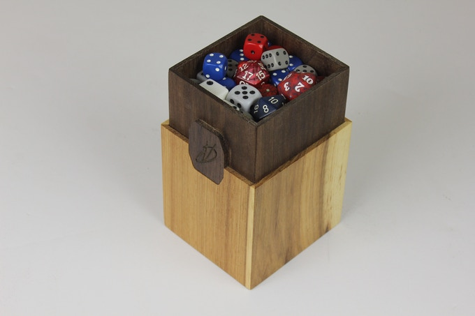 The dice compartment will store dice up to 1'' in diameter