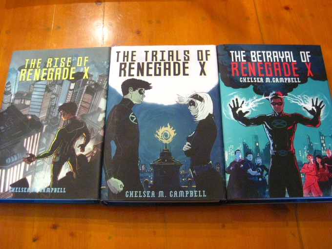 Hardback copies of books 1-3, with cover art by Raul Allen.
