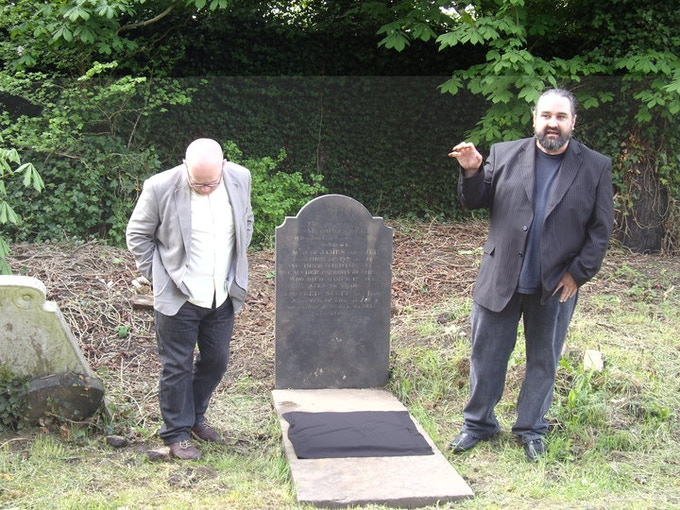 Quinn Jacobson (R) and Carl Radford (L) stand at F.S. Archer's grave in Kensal Green Cemetery. London, England 2010