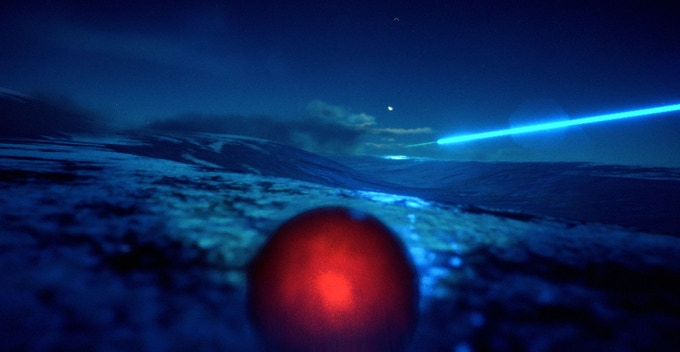EXO ONE glows red on a frozen world