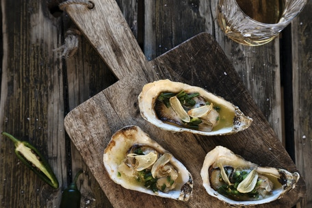 Grilled Oysters in Bourbon Butter, styled by Amanda. Photo by: Preston Drake-Hillyard