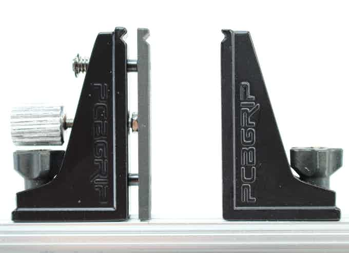 Adjustable (left) and fixed (right) vise faces.  Either face can be repositioned quickly using the large black thumb screws.  In addition, the adjustable vise face (left in this picture) allows for fine adjustment to securely hold the PCB.